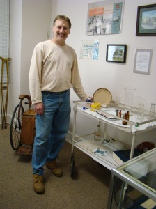 Dave Scott, owner, stands with medical supplies in their museum.