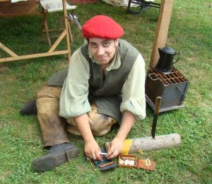Young settler makes a stem for his pipe.