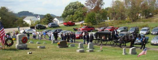 Funeral Procession arrives at Village View Cemetery.