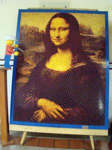 Lego Mona Lisa with Lego artist giving a final touch.