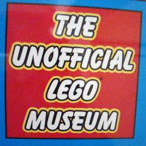 "The sign out front says ""Unofficial Lego Museum""."