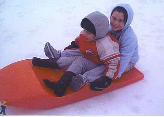 Children enjoy a sled ride.