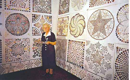 The late Freida Warther poses with some of her button creations.