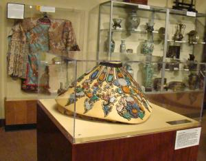 Chinese royalty collar with silk kimona and pottery in the background