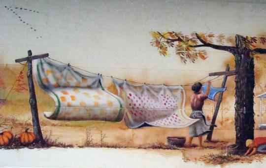 Mom hangs up clothes to dry. (Mural by C.M. Scott)