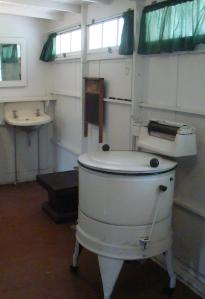 Laundry Room with wringer washer and washboard