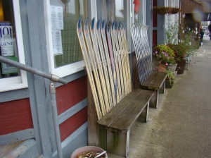 Benches with ski backs line the street.