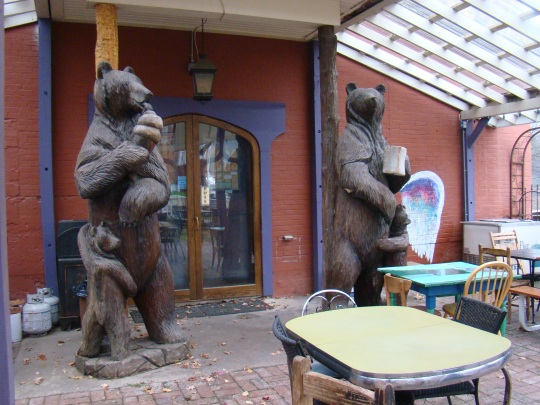 Carved wooden bears on the patio of Purple Fiddle