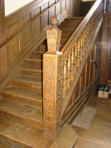 Stairway with carved newel post