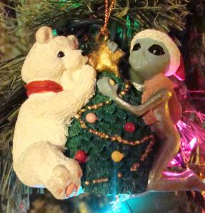 Alien from Roswell, NM helps bear trim the tree.