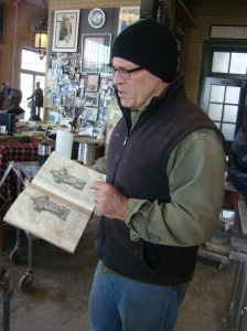 Alan with his Sculptor's Bible, an old anatomy book.