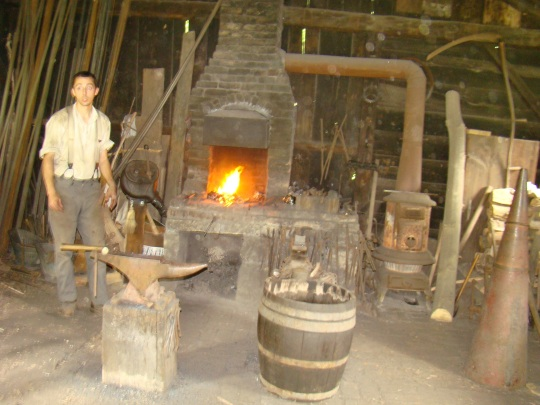 Blacksmith at work in his shop