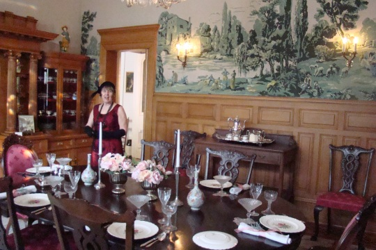 Guide, Shirley, describes the elegant dining room with silk screen wall covering.