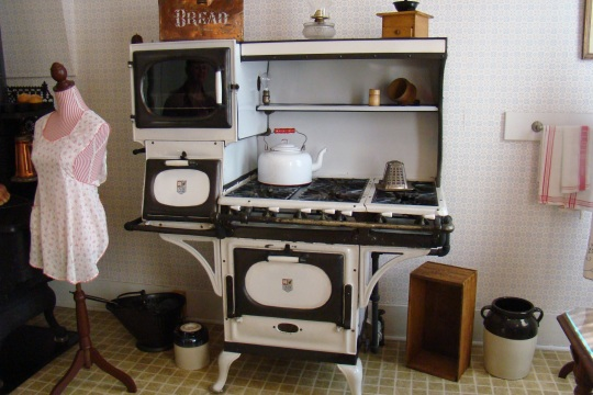 Reeves kitchen displays a warmer oven, local made teapot, and old-fashioned toaster.