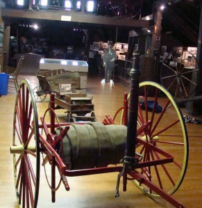 This horse drawn fire wagon had a two man seat, which was unusual at that time.