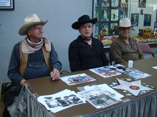 Look-a-likes John Wayne, enjoy visiting with the crowd.