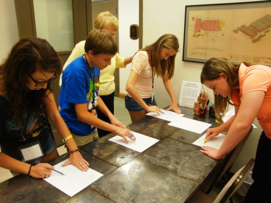 Students enjoy using the etching plates.