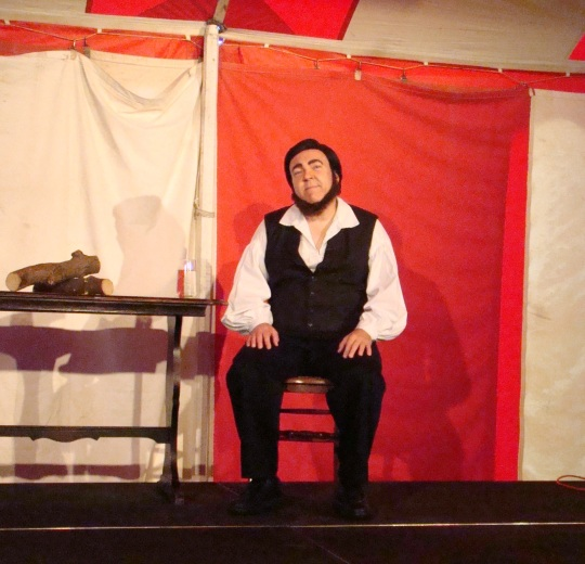 Thoreau relaxes on stage.
