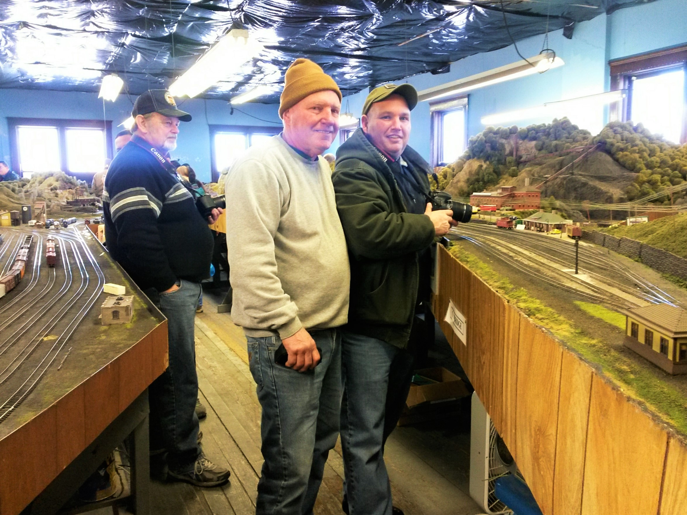 Dave and his son, Alan, look over their large HO display.