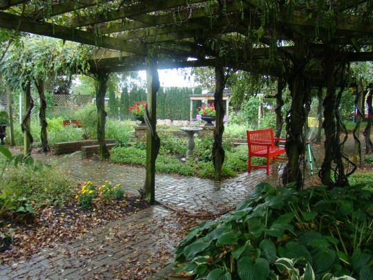 Relax under the arbor in the peaceful gardens.