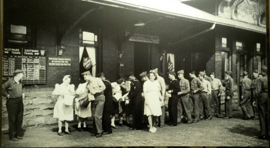 This picture from the WWII Canteen stop shows the GIs receiving food and cheer.