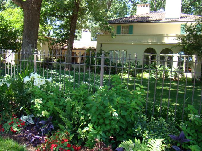 mission-oaks-home-surrounded-by-flowers