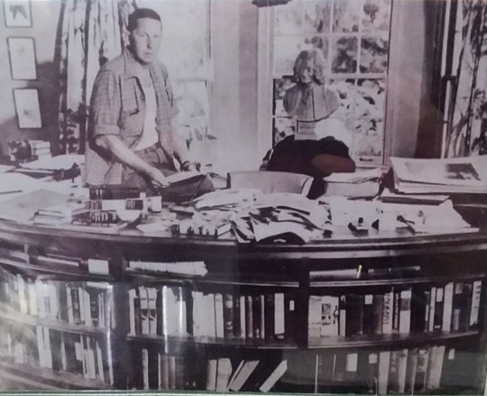 Malabar Bromfield at desk