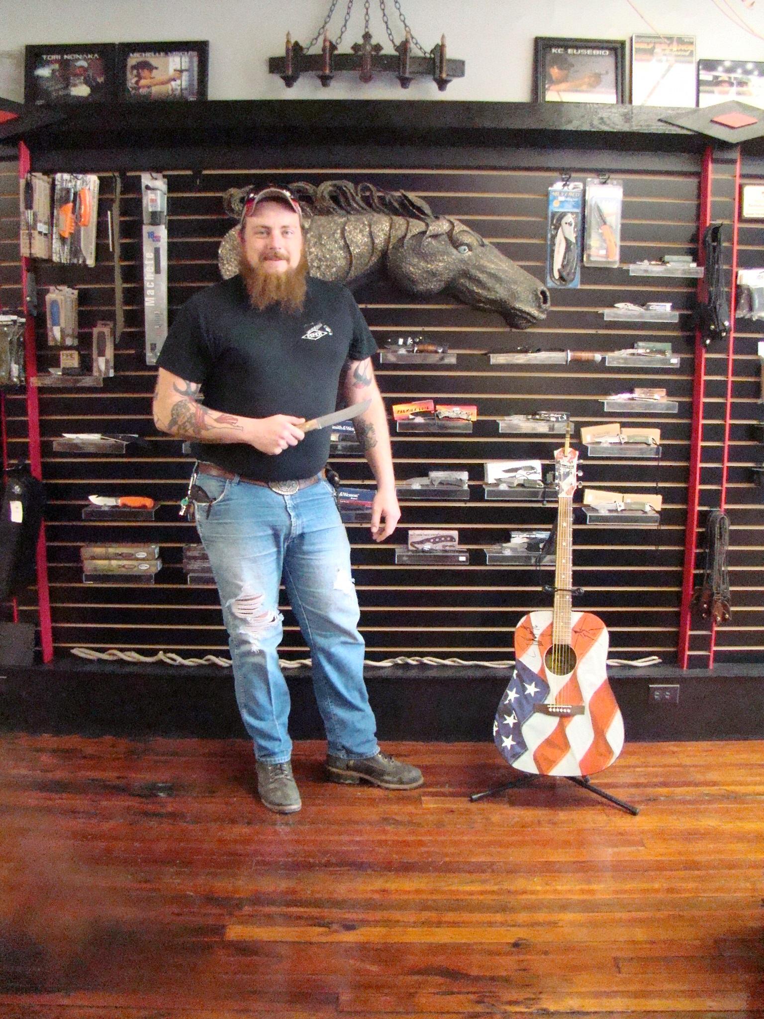 BHK Tom Casterline with Ted Nugent guitar