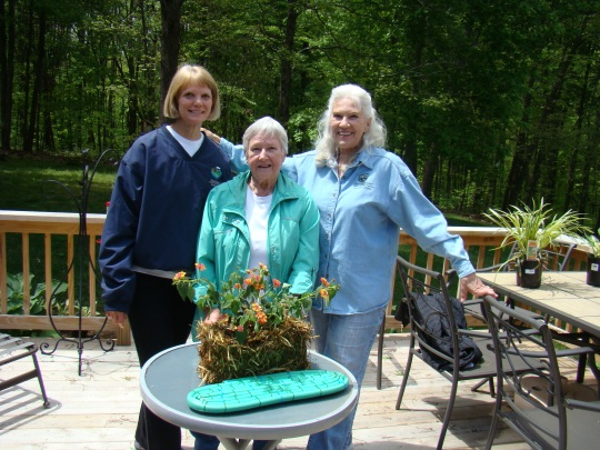 Pat and Garden Club friends sharing their straw bale garden.