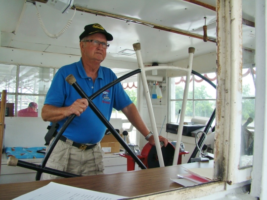 Captain Bill at wheel